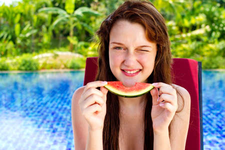 A young and attractive woman eating watermelon outdoor Stock Photo - 10307131