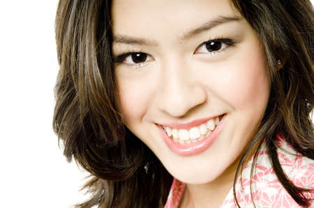A close-up portrait of a young beautiful woman with great smile on white background