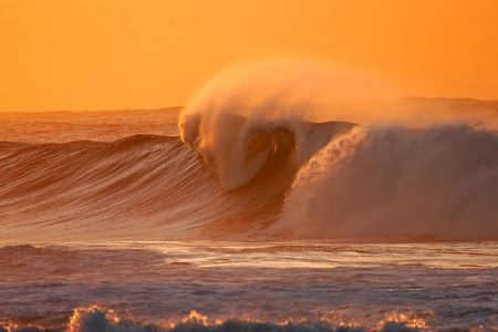 Seascape at sunset with large breaking wave