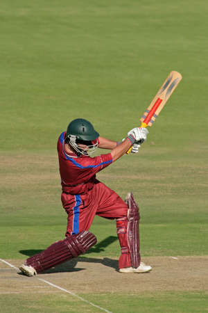 A cricket batsman in action  photo