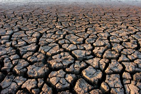 waterless: Cracked, parched land after a drought