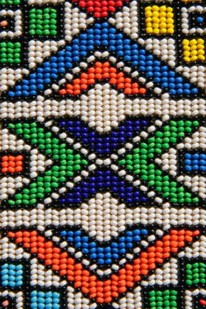 a beads: Colorful African beads depicting traditional African shapes  Stock Photo
