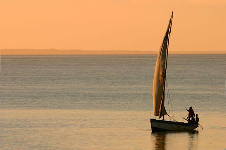 Traditional sail boat called a dhow at sunset, Vilanculos coastal sanctuary, Mozambique Stock Photo - 819671