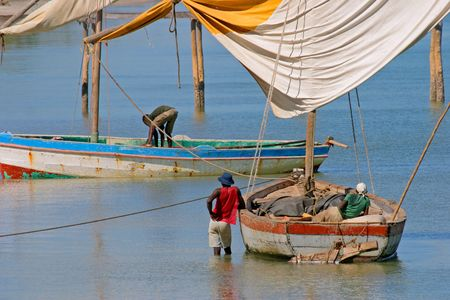 Fishermen and their traditional sail boats (dhows), Vilanculos coastal sanctuary, Mozambique Stock Photo - 885572