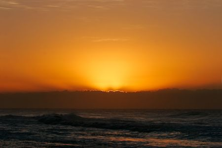 Cloud with golden lining at sunrise over the ocean Stock Photo - 893517