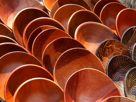 polished wood: Hand made wooden bowls carved from the wood of indigenous African trees