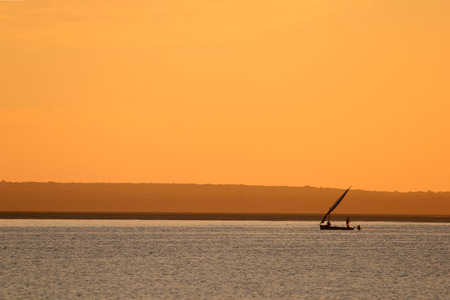 Mozambique: Sunset with traditional sail boat called a dhow, Vilanculos coastal sanctuary, Mozambique