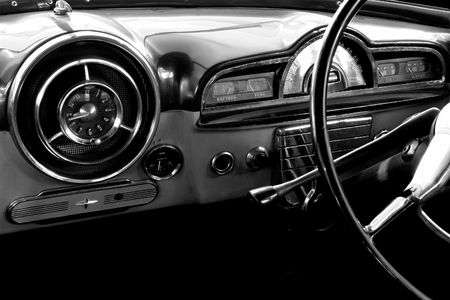 bygone: View of the interior of an old vintage car in black and white Stock Photo