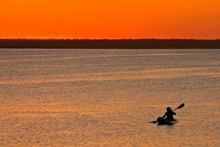 Golden sunset with canoeist, Vilanculos coastal sanctuary, Mozambique Stock Photo - 3027900