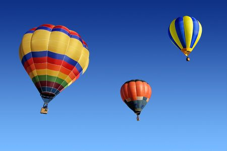 Colorful hot air balloons against a clear blue sky photo