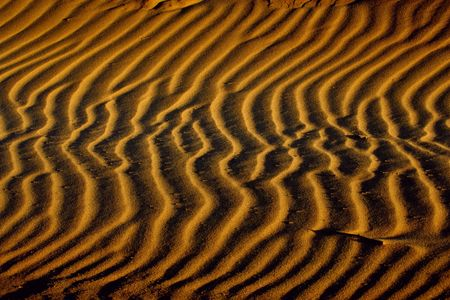 Patterns in the sand created by the wind Stock Photo