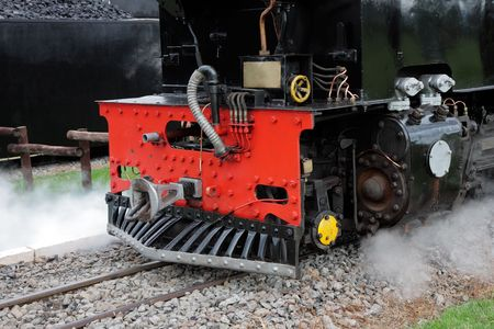 Close-up of the front of a vintage steam locomotive with steam Stock Photo - 4529946
