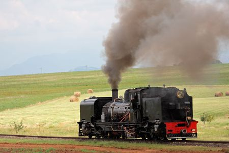 Vintage steam locomotive with billowing smoke and steam Stock Photo - 4529947