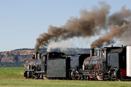 billowing: Two vintage steam locomotives with billowing smoke and steam Stock Photo