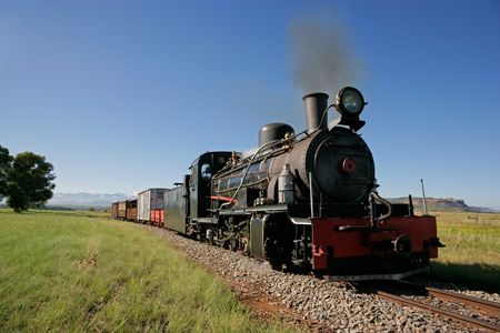 Front view of a vintage steam locomotive with carts Stock Photo - 4787094