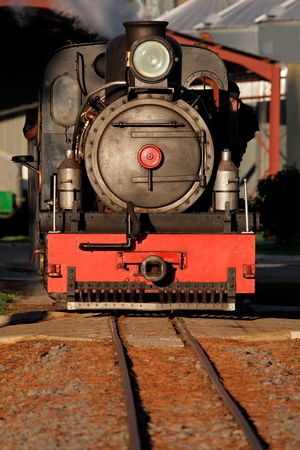 Front view of a vintage steam locomotive on a railway track Stock Photo - 4819353