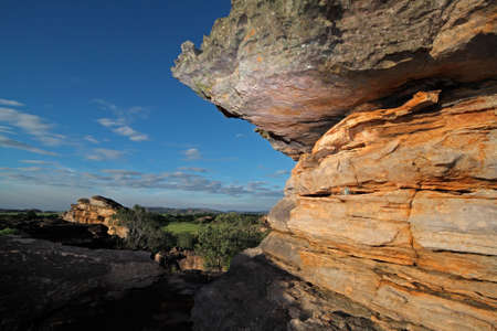 Sandstone rock in late afternoon light at Ubirr rock art site, Kakadu National Park, Northern Territory, Australia photo