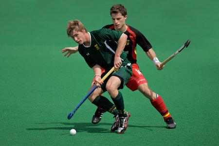 hockey sobre cesped: Acci�n de Bloemfontein, Sud�frica - el 14 de marzo de 2009 - durante un juego de hockey sobre hierba de mens internacional entre Alemania y Sud�frica (Alemania gan� 4-3) Editorial