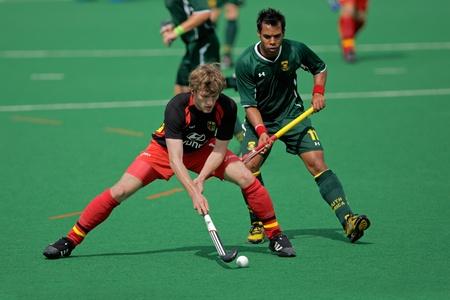 hockey sobre cesped: Acción de Bloemfontein, Sudáfrica - el 14 de marzo de 2009 - durante un juego de hockey sobre hierba de mens internacional entre Alemania y Sudáfrica (Alemania ganó 4-3)