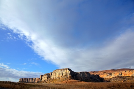 geological: Sandstone rock against a blue sky with clouds, Golden Gate National Park, South Africa