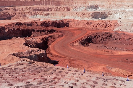 open cast mine: Large, open-pit iron ore mine showing the various layers of soil and iron rich ore
