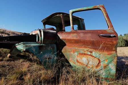 abandoned car: Wreck of a rusty old pickup truck out in the field LANG_EVOIMAGES