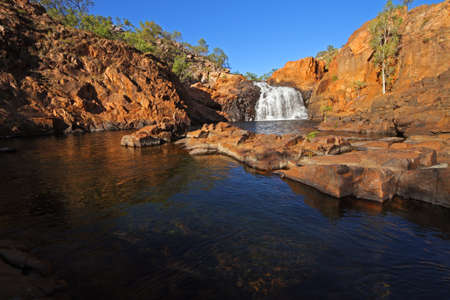 Small waterfall and pool with clear water, Kakadu National Park, Australia photo