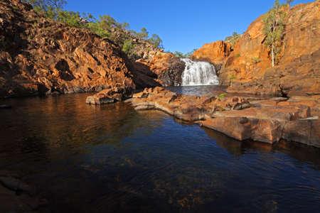 australia landscape: Small waterfall and pool with clear water, Kakadu National Park, Australia