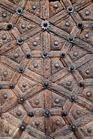 Antique, hand crafted wooden door, Stone Town, Zanzibar photo