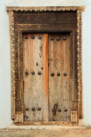 hand crafted: Antique, hand crafted wooden door, Stone Town, Zanzibar Stock Photo