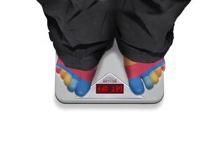Overweight person standing on scales (it says