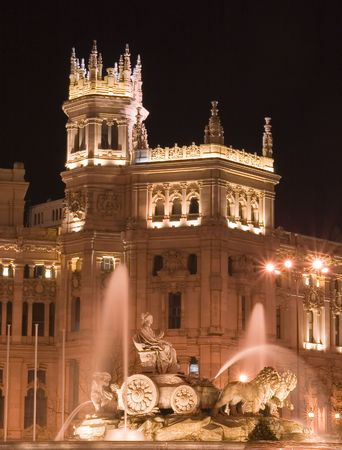 Plaza de Cibeles in Madrid, Spain at night.  With Cibeles Fountain and the Royal Mail office in the background (Palacio de Comunicaciones or Correos).