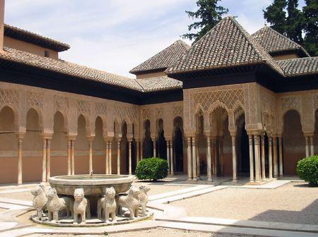Patio of the Lions (El Patio de los Leones) in the Alhambra a moorish mosque, palace and fortress complex in Granada, Spain. Editorial