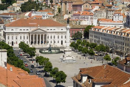 bullfights: View of the Rossio Square from the Santa Justa Lift in Lisbon, Portugal.  Also known as Pedro IV Square (Pra�a de D. Pedro IV), it has been one of its main squares since the Middle Ages. It has been the setting of popular revolts and celebrations, bullfights and executions, and is now a preferred meeting place of Lisbon natives and tourists alike. Stock Photo