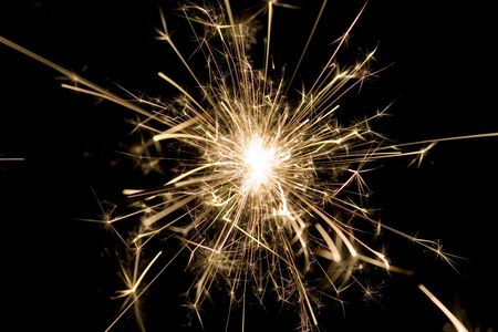 Yellow sparkler used for celebrations photo