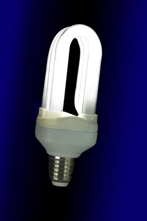 Fluorescent light bulb lit on a black background photo