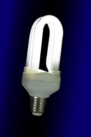 halogen lighting: Fluorescent light bulb lit on a black background