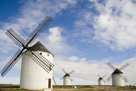 Medieval windmills dating from the 16th century overlooking the town of Campo de Criptana in Ciudad Real province, Castilla La Mancha, central Spain.  Made famous in Miguel de Cervantes Saavedras novel Don Quijote de la Mancha, these windmills are situat photo