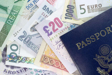US Passport and assorted currencies from around the world. photo