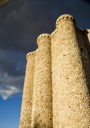 partially: Villarejo de Salvanes Castle (Castillo de Villarejo de Salvanes) in the south of the Community of Madrid, Spain.   Built in the 14th or 15th century, is of unique architecture.  Partially in ruins, only the tower remains.