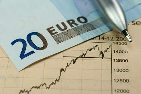 20 Euro banknote with pen and rising stock chart