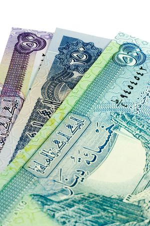Iraqi banknotes isolated on a white background. photo