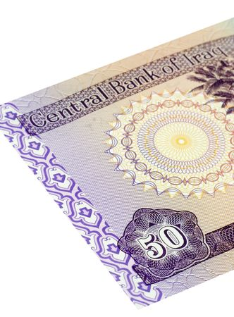 Fifty Iraqi dinars banknote isolated on a white background with focus on the 50. photo