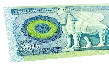 Five Hundred Iraqi dinars banknote isolated on a white background with focus on the 500. photo