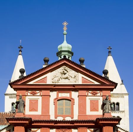 Facade of St. Georges Basilica (Basilika sv. Jiri) at Prague Castle, Czech Republic.  Basilica dates originally from 921AD, although the facade is from the 17th century. Stock Photo