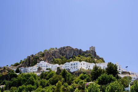 whitewashed: Zahara de la Sierra is a white village (Pueblo Blanco) in Cadiz province, Andalucia, Spain.  It features a castle built overlooking the whitewashed houses of the village