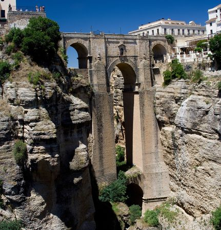nuevo: The Puente Nuevo (new bridge) in Ronda, Spain spans the 120m deep chasm which divides the city. Stock Photo