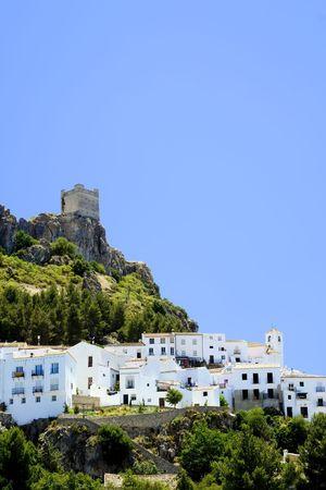 Zahara de la Sierra is a white village (Pueblo Blanco) in Cadiz province, Andalucia, Spain.  It features a castle built overlooking the whitewashed houses of the village photo