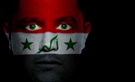 iraqi: Iraqi flag paintedprojected onto a mans face. Stock Photo