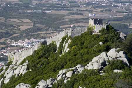 sintra: The Castelo dos Mouros (Castle of the Moors) is located in Sintra, Portugal.  Situated on a high hill overlooking the village, it is part of the Cultural Landscape of Sintra, recognised as an UNESCO World Heritage Site. Stock Photo